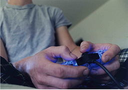 256px-Tex_playing_video_games