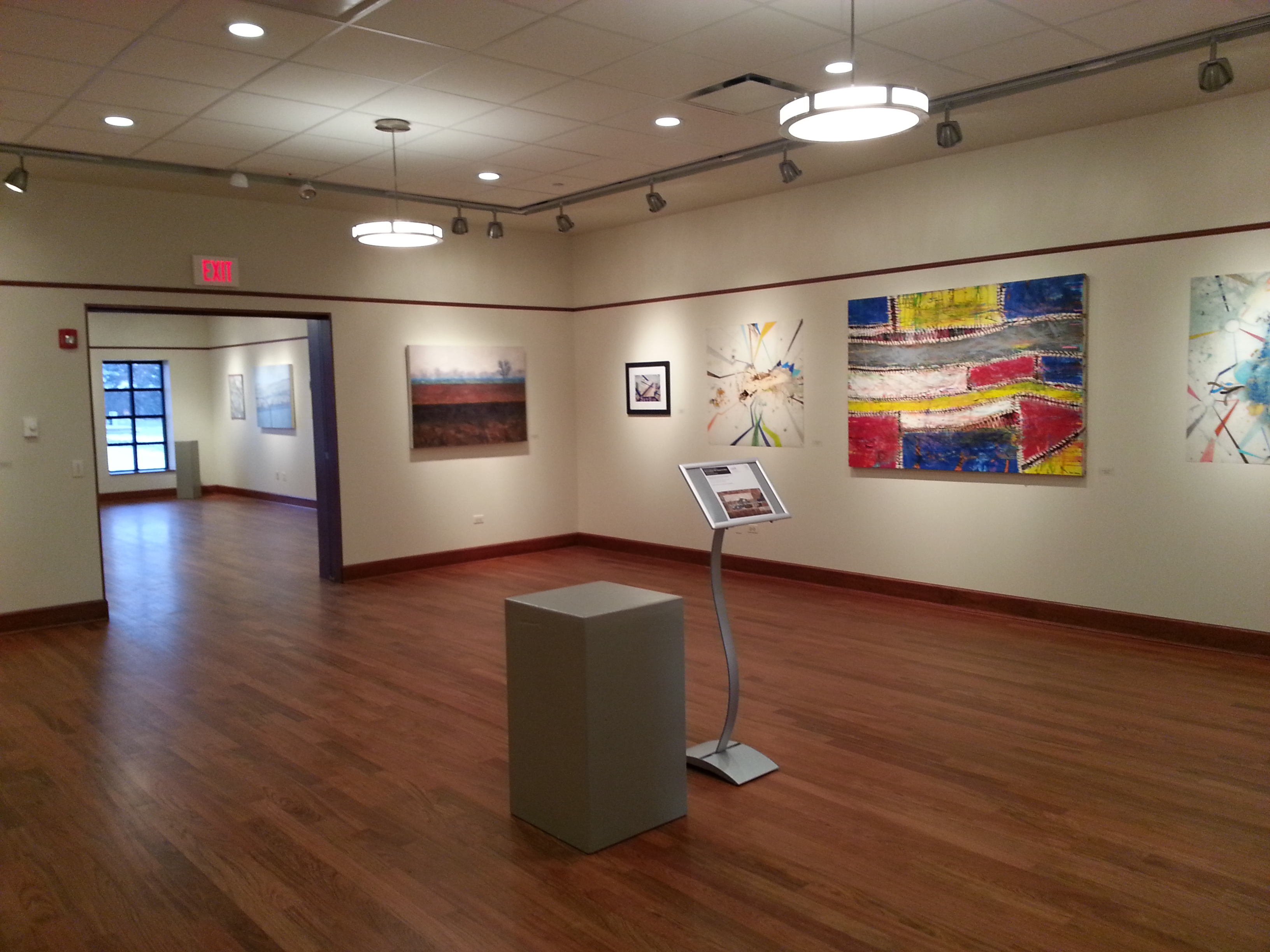 "Pictured is the Lewis University inaugural exhibit,  ""The President's Fifth Annual Art Show"" in February 2012. The exhibit featured the work of various Lewis students and alumni. The Art Gallery is located in a new addition to the Oremus Fine Arts Center on the Lewis campus in Romeoville."